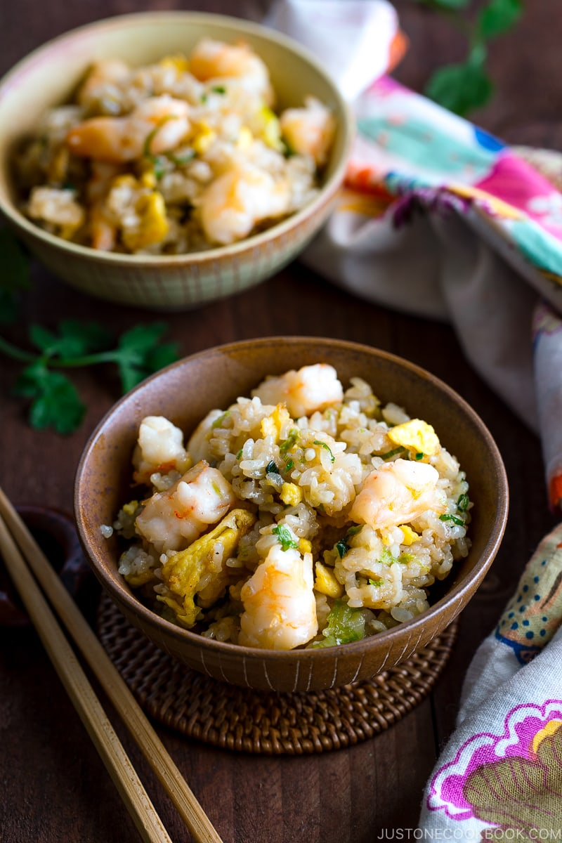 Rice bowls containing shrimp fried rice.