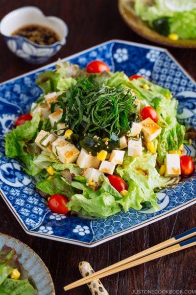Refreshing Tofu Salad with Sesame Ponzu Dressing on a Japanese blue platter.