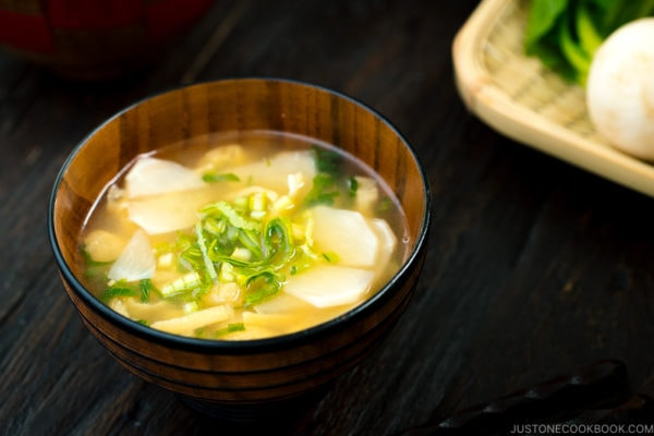 Three kinds of vegetable miso soups; each served in a Japanese wooden bowl.