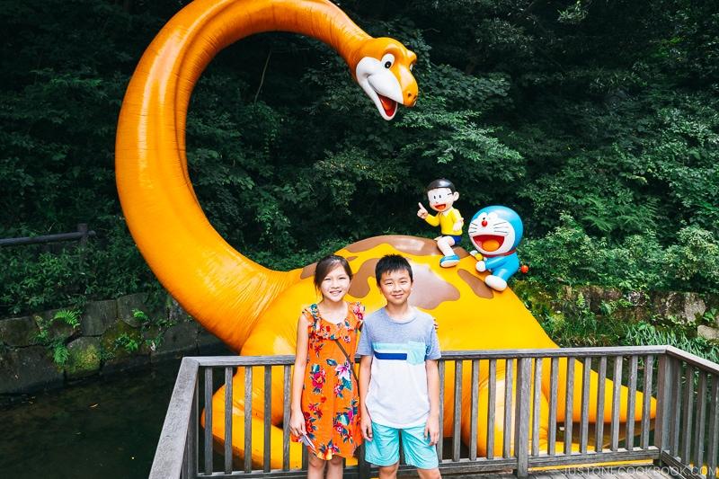 children posing in front of dinosaur - Fujiko F Fujio Museum | www.justonecookbook.com