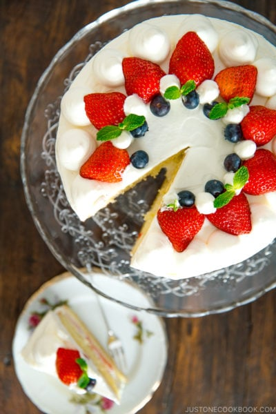 Strawberry shortcake on a cake stand.