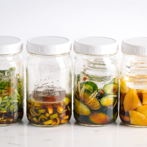 4 Mason jars, each filled with a different soy sauce pickles.