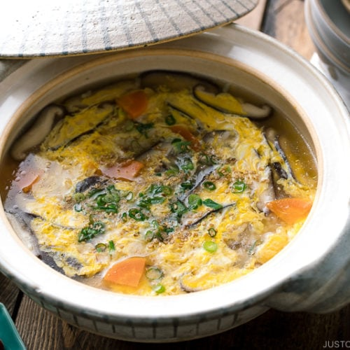 Chicken Zosui (Japanese rice soup) served in a donabe, Japanese earthenware pot.