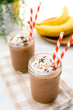 Chocolate banana smoothies in a mason jar.