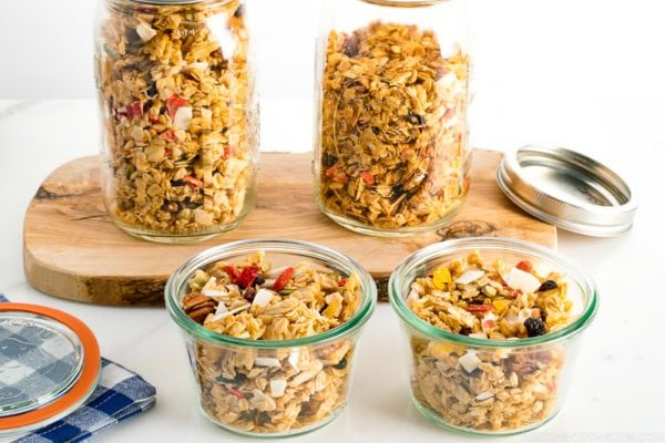 Mason jars and Weck jars containing homemade granola.
