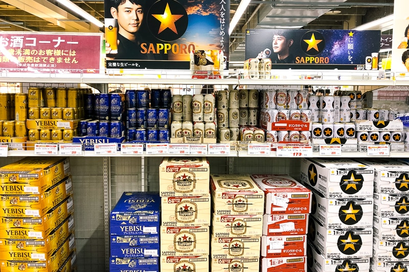 beers on a shelf in a Japanese supermarket