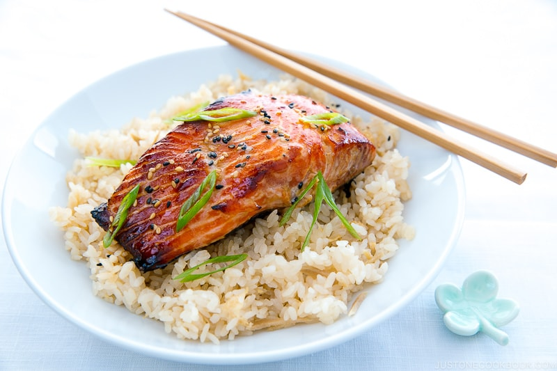 A white bowl containing miso salmon over ginger rice.