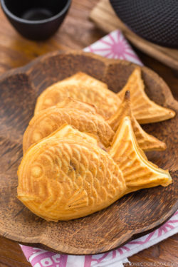 Taiyaki served on a wooden plate.