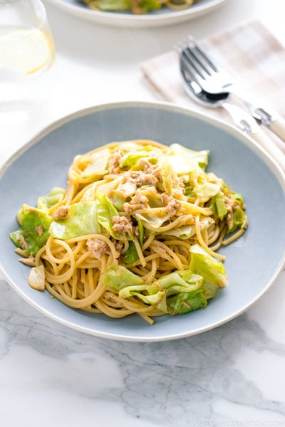 A blue plate containing Japanese-style Tuna and Cabbage Pasta.