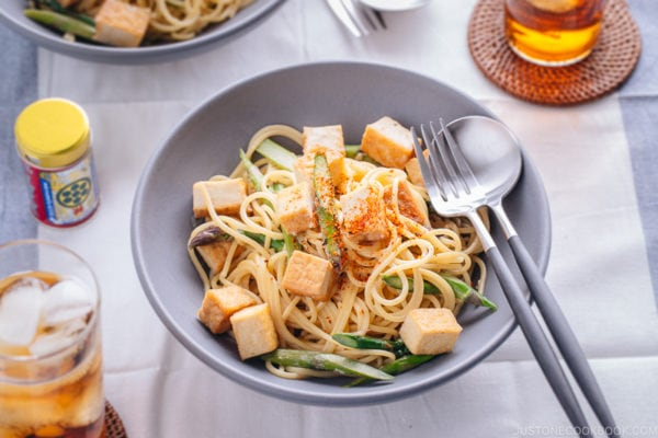A grey bowl containing Creamy Miso Pasta with Tofu and Asparagus.