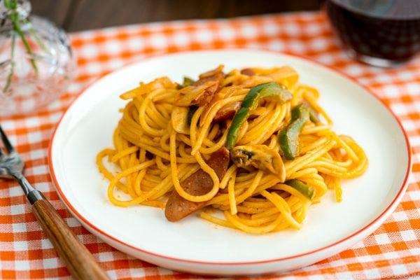 A white plate containing Japanese Ketchup Spaghetti (Napolitan).