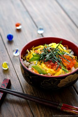 A Japanese-style bowl containing colorful Chirashi Sushi.