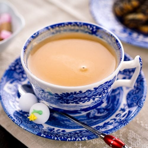Royal milk tea in a blue and white tea cup.