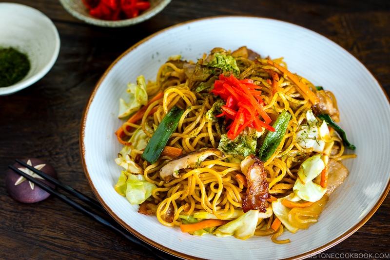 A white plate containing Yakisoba (Japanese Stir Fry Noodles).