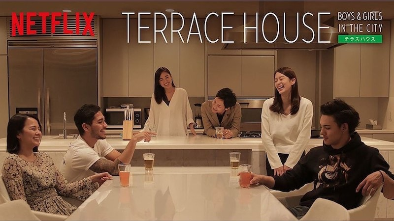 A group of people sitting at a table for terrace house ad