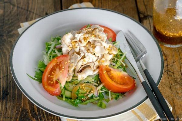 A white dish containing Shabu Shabu Salad.