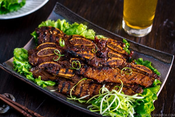 Plates containing Korean-style marinated bbq ribs.