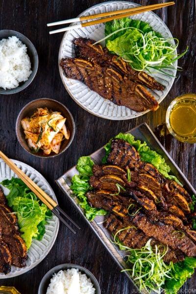 Plates containing Korean-style marinated bbq ribs.