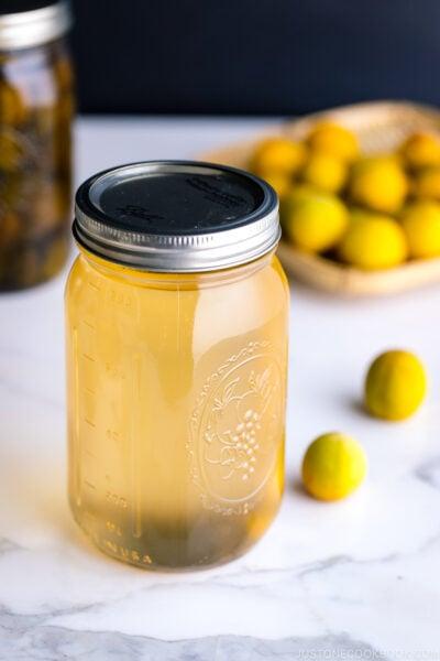 A mason jar containing ume plum syrup.