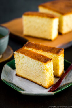 Two slices of Castella (Honey Cake) served on a plate.