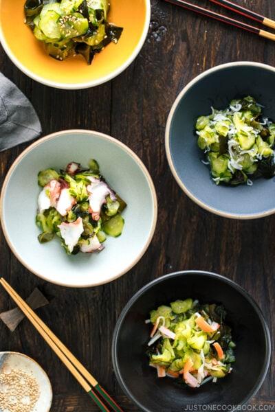 4 kinds of Sunomono (Japanese Cucumber Salad) in bowls..