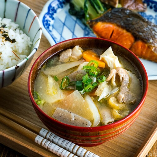 Tonjiru (Pork and Vegetable Soup) served with grilled salmon, steamed rice, and vegetable side dishes.
