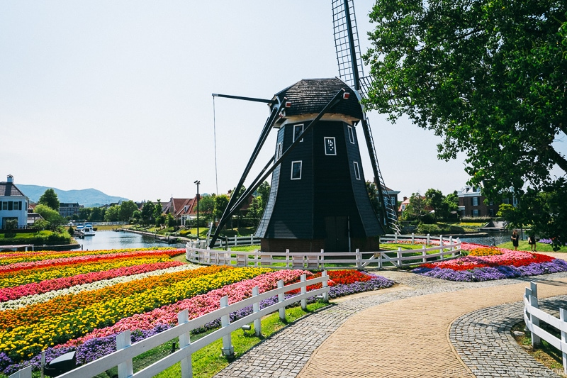 windmill next to flower bed