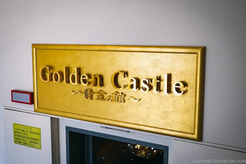 gold sign that says golden castle