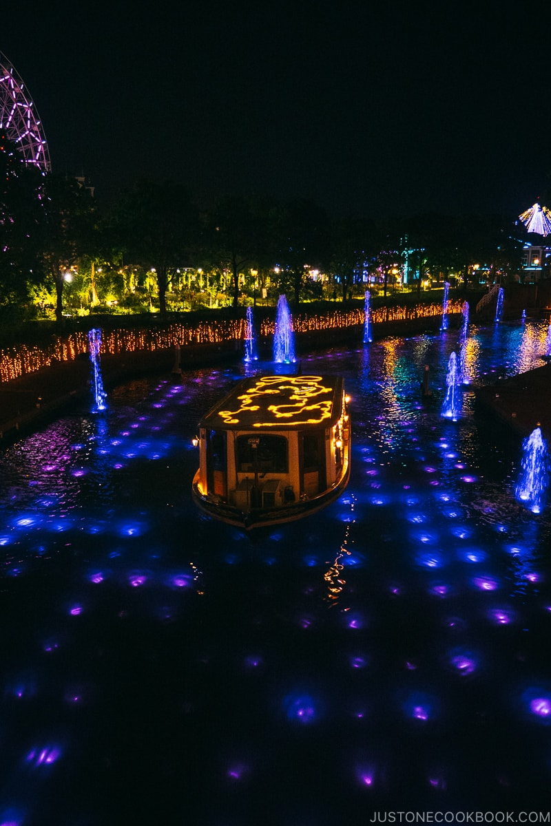 a boat in the canal lite up at night