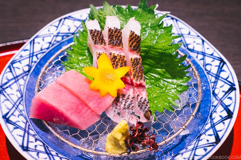 assorted sashimi on a blue and white plate
