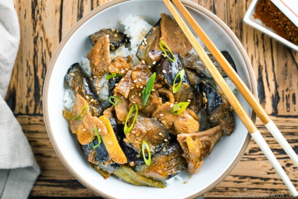 A bowl containing Miso Pork and Eggplant Stir-Fry over steamed rice.