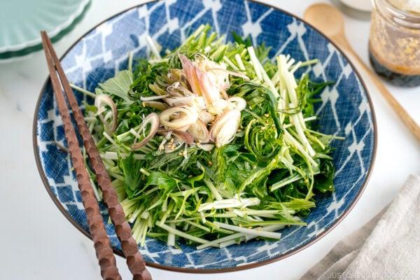 A blue Japanese bowl containing Mizuna Myoga Salad.