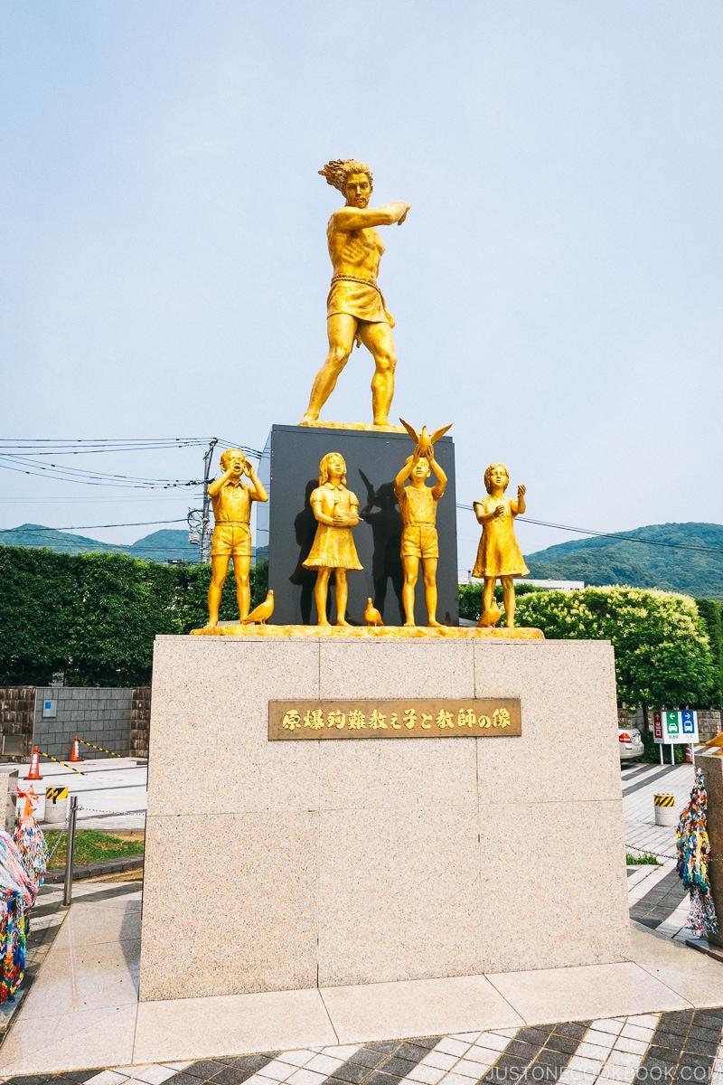 gold peace memorial Statue in Memory of Schoolchildren and Teachers