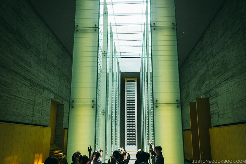 a large room with lit up columns and skylight at Nagasaki National Peace Memorial Hall for the Atomic Bomb Victims