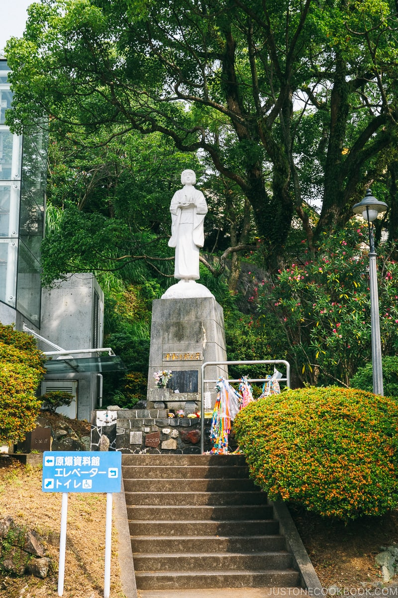 statue of praying child on top of the steps