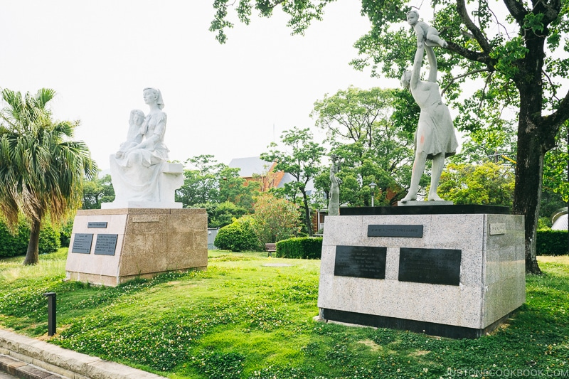 monuments and statues symbolizing peace on pedestal and grass