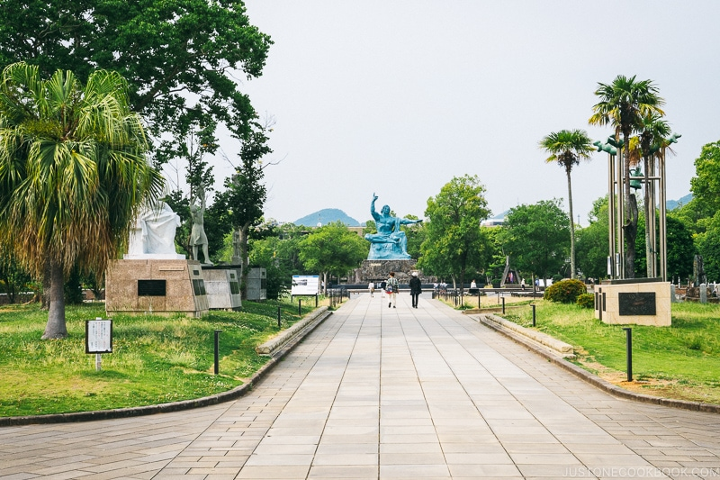 walkway with peace statue at the end