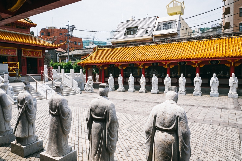 the courtyard lined with statues at Nagasaki Koshibyo Confucius Shrine and Historical Museum of China