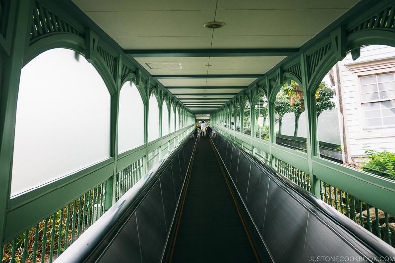 covered long escalator heading up