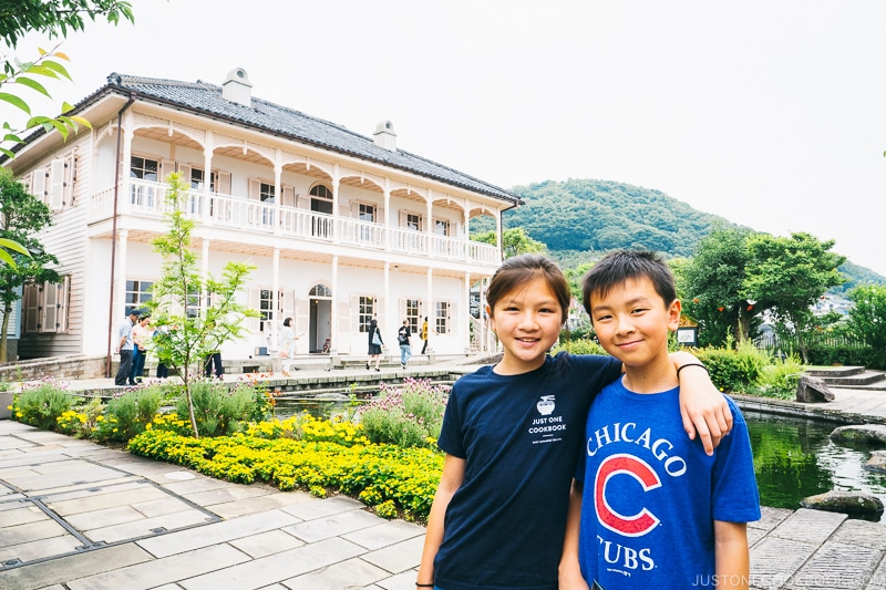 two children in front of former Mitsubishi dock house