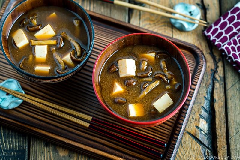 Japanese wooden bowls containing Nameko Mushroom Miso Soup.