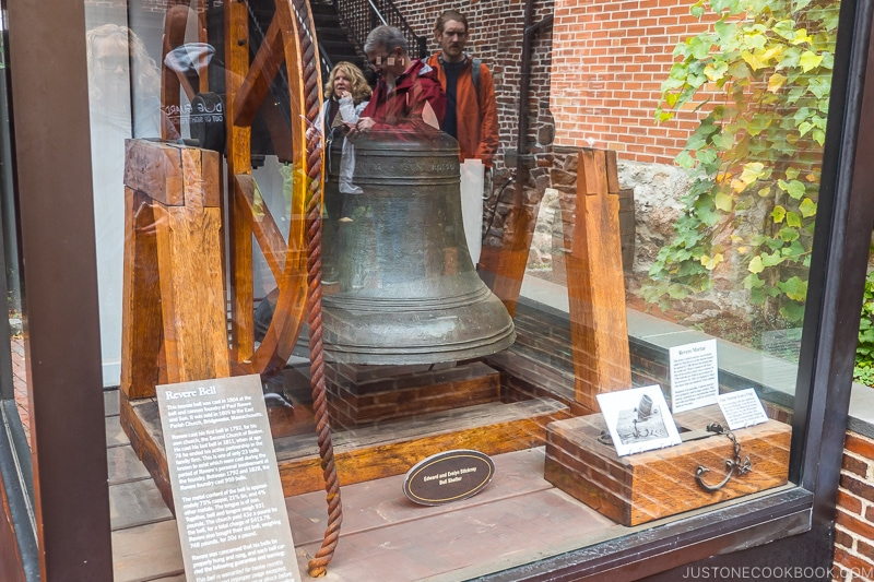 Revere Bell on display in a glass enclosure
