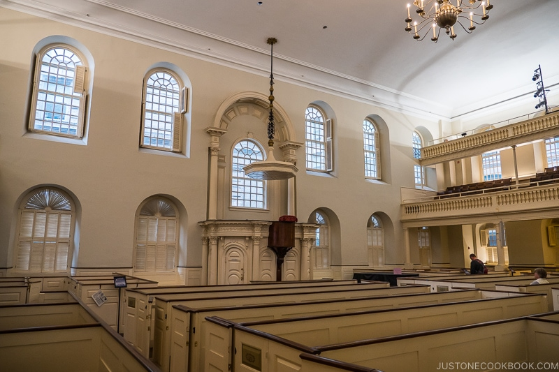 the hall at Old South Meeting House with seating area and a raise platform in the center