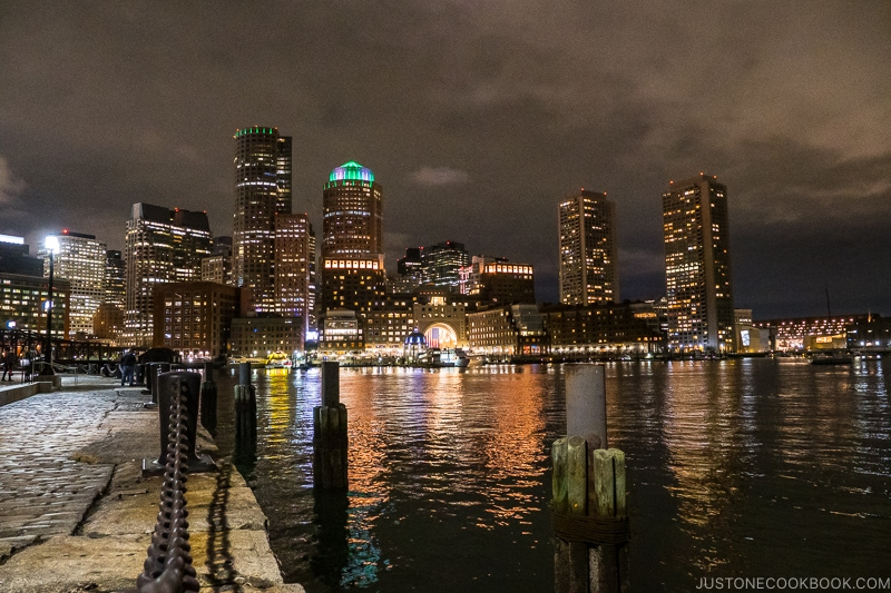 view of buildings in downtown Boston from Fan Pier Park at night