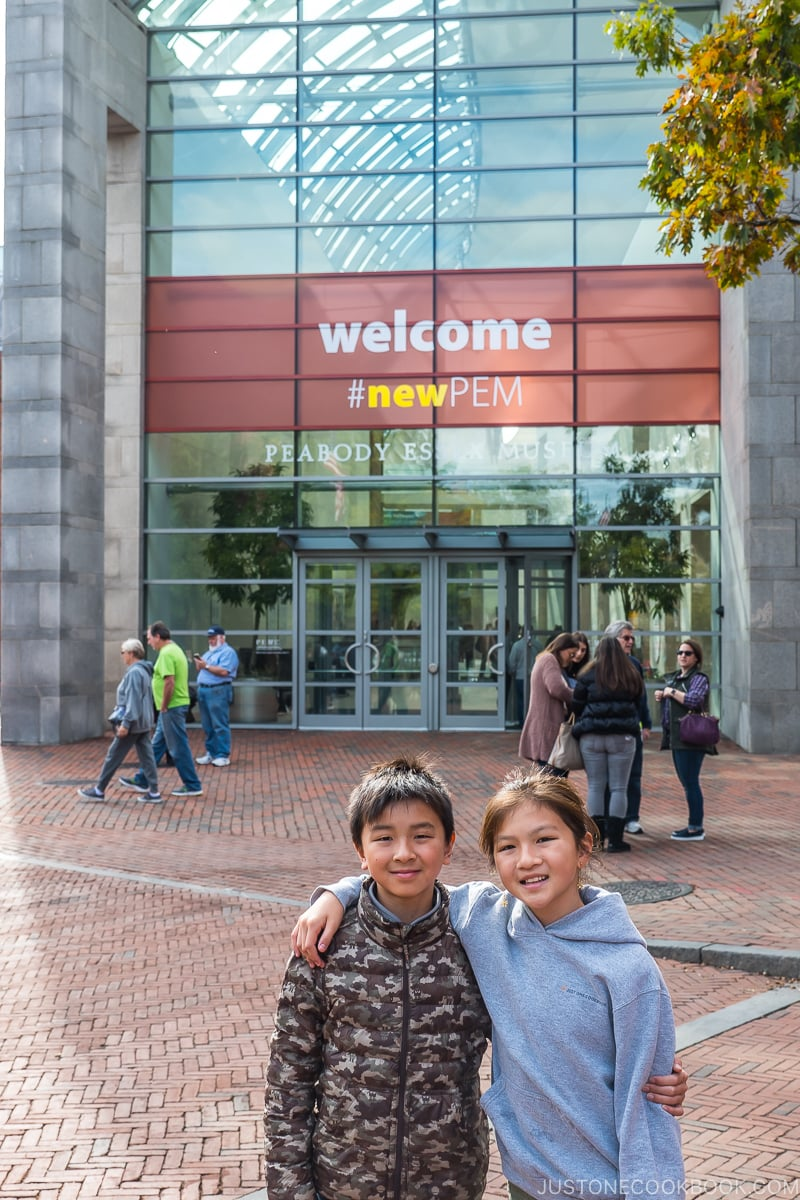 two children standing in front of Peabody Essex Museum