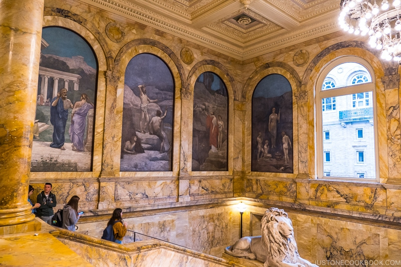 marble walls and paintings inside Boston Public Library