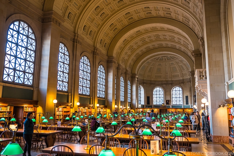 large hall with desks inside Boston Public Library