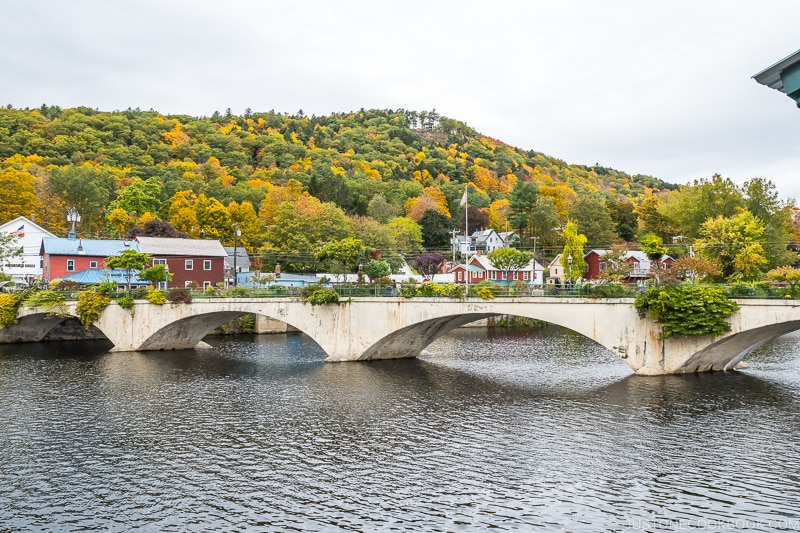 Bridge of Flowers across the Deerfield River with a hill in the background