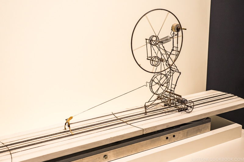 exhibition at MIT Museum with a wishbone pulling a metal structure