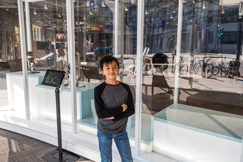boy standing in front of exhibition at MIT Museum